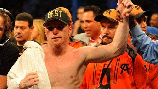 Canelo Alvarez is named the victor over Erislandy Lara after a 12-round super welterweight bout at MGM Grand.
