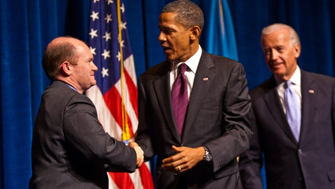Sen. Chris Coons, D-Del., greets President Barack Obama on the stage at the Grand in Wilmington in October 2010. Obama headlined a fundraiser for Coons' first Senate campaign.