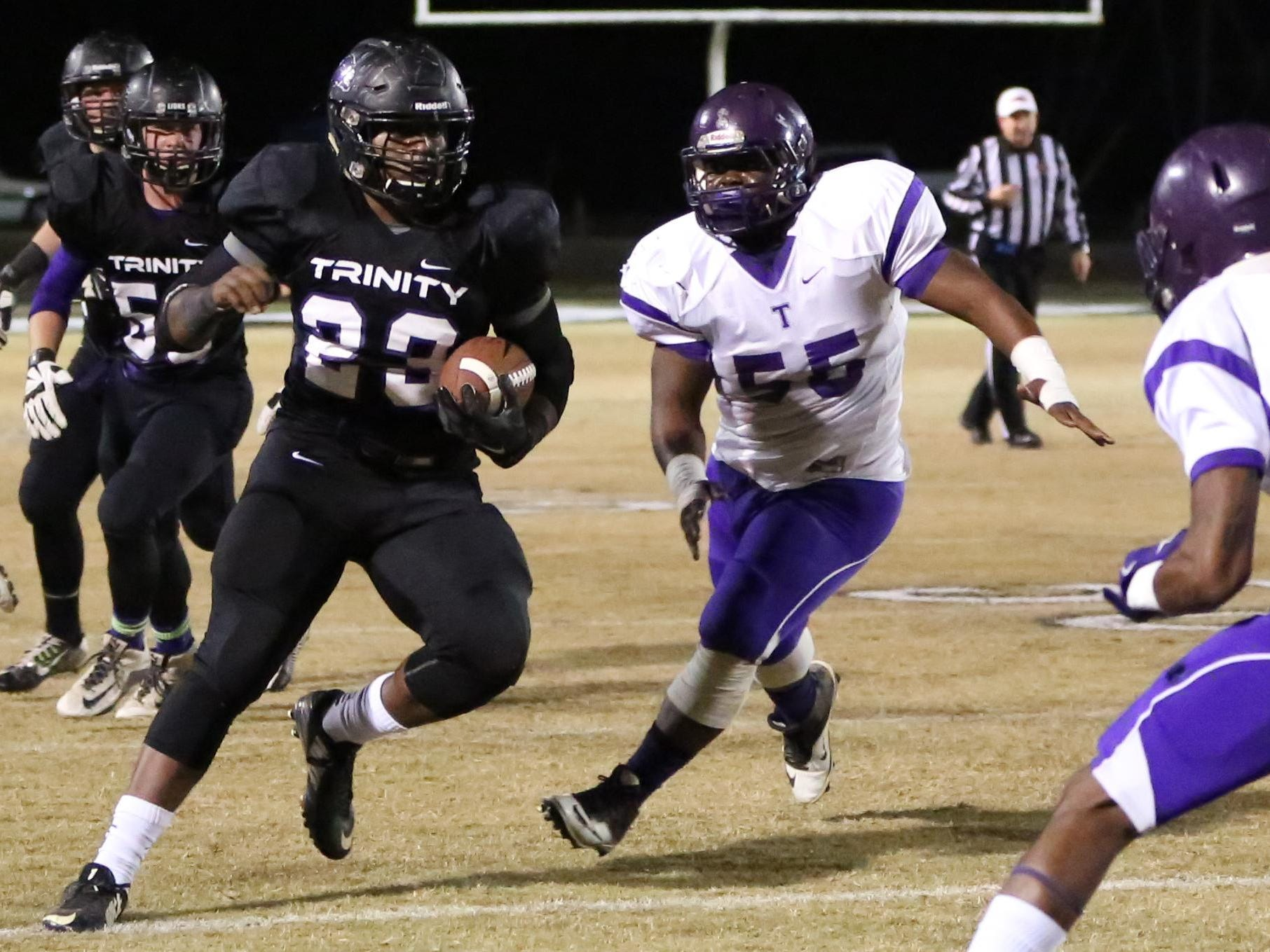 Trinity's Chris Tucker runs the ball against the Memphis Trezevant defense in Friday's Class 2A semifinal in Jackson.