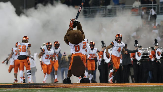 Nov 29, 2014; Corvallis, OR, USA; Oregon State Beavers mascot holds a chain saw up in the air before the game against the Oregon Ducks at Reser Stadium.