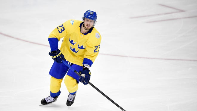 Sweden defenseman Oliver Ekman-Larsson (23) skates with the puck against Europe during the third period of an exhibition game, part of the World Cup of Hockey, Wednesday, Sept. 14, 2016, in Washington. Europe won 6-2.