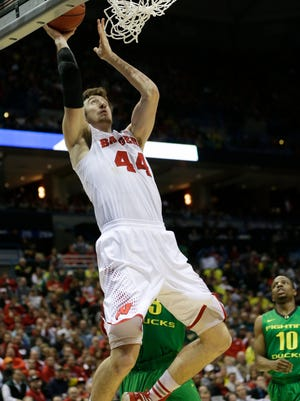 Wisconsin Badgers forward Frank Kaminsky (44) shoots a layup in the second half of a men's college basketball game against the Oregon Ducks during the third round of the 2014 NCAA Tournament at BMO Harris Bradley Center.