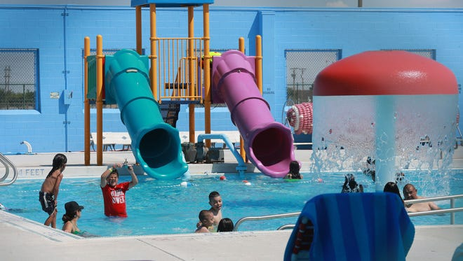 Children cool off in the Ascarate Park wading pool Friday.