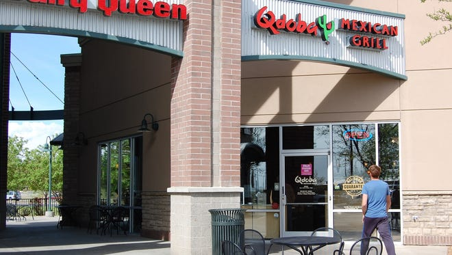 A customer head for Qdoba at Lemay Avenue and Mulberry Street on Friday.