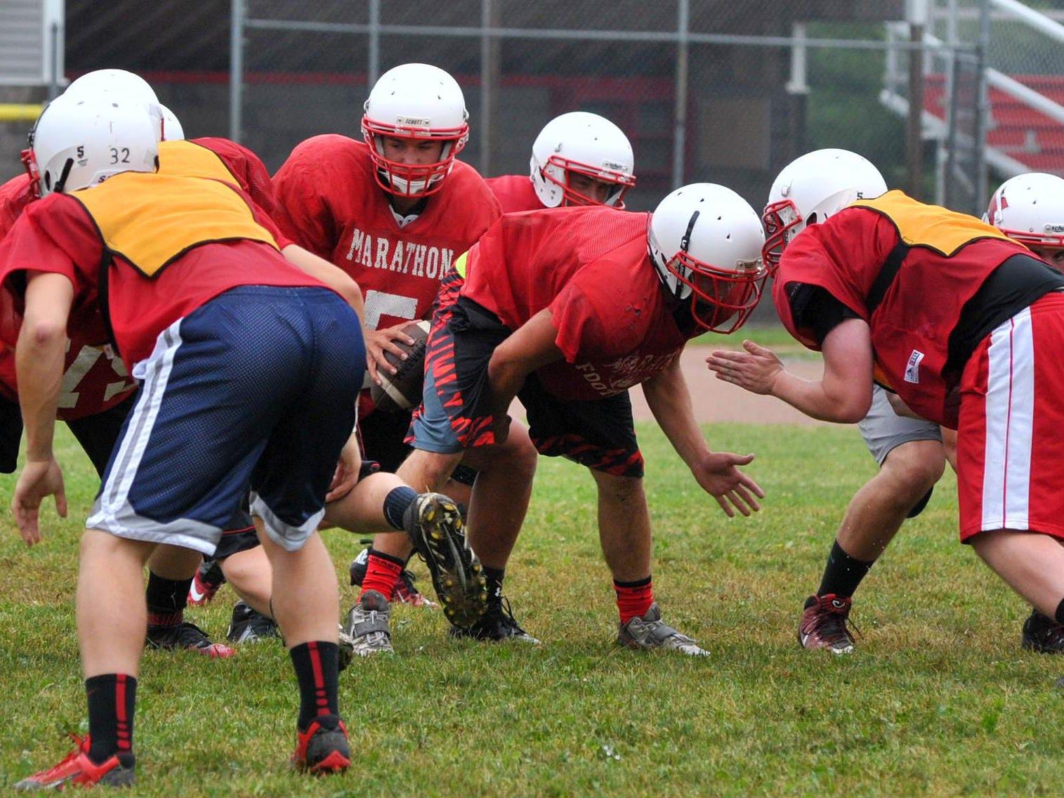 Marathon's football team rehearses drill during Friday football practice at Marathon High School.