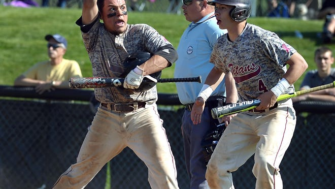 Greece Arcadia's Bryan Rivera, left, and Kevin Blum, who had two RBI, celebrate a five-run first inning during a Class A1 sectional quarterfinal on Friday. The top-seeded Titans won 6-2.