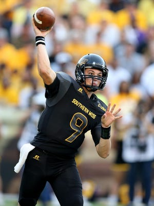 Southern Miss Golden Eagles quarterback Nick Mullens (9) makes a throw during the first quarter of their game against the Savannah State Tigers  on Saturday at M.M. Roberts Stadium in Hattiesburg.