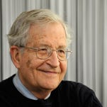Noam Chomsky leads a panel discussion at The Little Theatre on April 22.