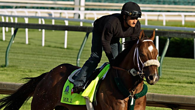 Exercise rider Edvin Vargas gallops Kentucky Derby hopeful Mr. Z  at Churchill Downs in Louisville, Ky., Monday, April 27, 2015.  (AP Photo/Garry Jones)
