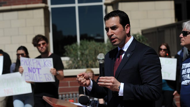 """State Sen. Ruben Kihuen speaks during a protest against the """"campus carry"""" bill at the University of Nevada in Reno on March 25.  Kihuen, D-Las Vegas, will serve as master of ceremonies at tonight's NAACP awars banquet."""