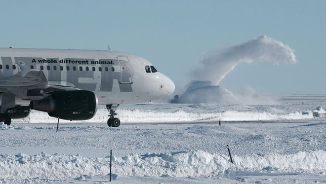 File photo: Snow movers work to clear the runways at Denver International Airport in 2006.