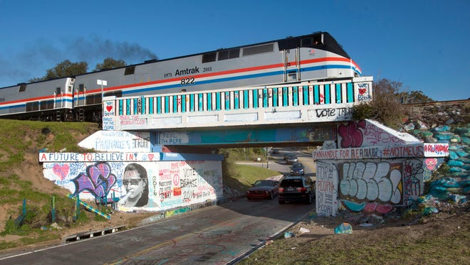 An Amtrak train crosses the iconic 17th Avenue railroad trestle after making a stop in Pensacola on Feb. 19, 2016. The Pensacola stop was part of the Southern Rail Commission's Gulf Coast Passenger Rail Inspection trip.