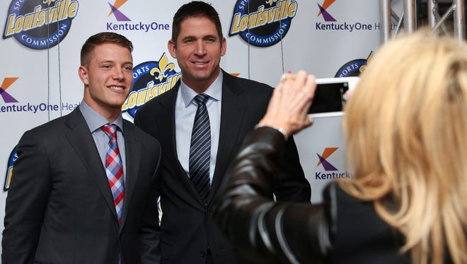 Ed McCaffrey, right, poses for a photo with his son Christian McCaffrey during this 2016 file photo. The elder McCaffrey was named head football coach at the University of Northern Colorado on Thursday, Dec. 12, 2019.