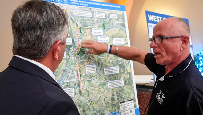 Darrell Littrell (right) talks with Ken Sperry about the two west routes for the proposed I-69 bridge crossing at the I-69 bridge route open house held at Milestones Crescent Room Monday. Littrell owns property along the routes and was concerned about placement and highway noise, July 31, 2017.