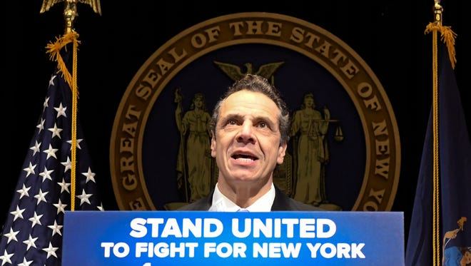 New York Gov. Andrew Cuomo delivers his 2018 executive state budget proposal during a news conference at the Clark Auditorium in Albany, N.Y., Tuesday, Jan. 16, 2018.