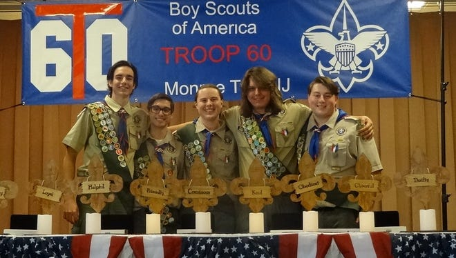 Five scoutsfrom Troop 60 were celebrated May 21 with an Eagle Court of Honor. The event, held at theMonroe Township Senior Center, officiallyinducted Joseph Vitale, Robert Reina, Donald Owen, Henry Haligowski and Dominic Lepri. All five areseniors at Monroe Township High School.