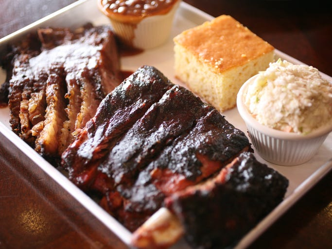 A combination plate with brisket and ribs, cornbread, baked beans and coleslaw,  at Q Restaurant in Port Chester, May 8, 2014.  Combination plates can be any two meats.
