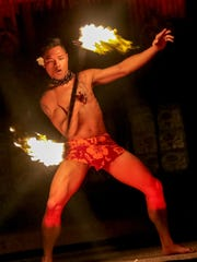 Perry Castro of the Mana Hune dance group performs