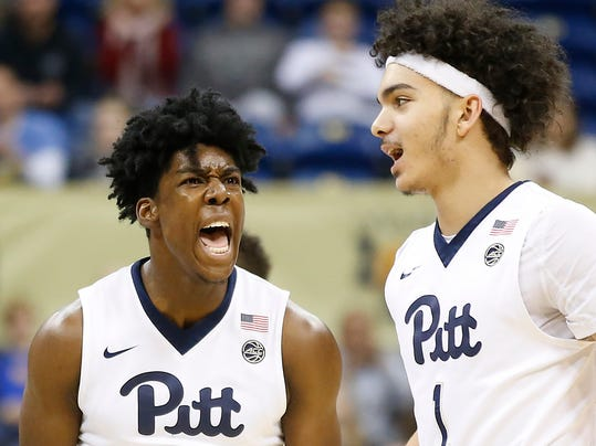 Pittsburgh guard Marcus Carr (5) celebrates with teammate Parker Stewart (1) following a basket against Georgia Tech in the first half of an NCAA college basketball game, Saturday, Jan. 13, 2018, in Pittsburgh. (AP Photo/Jared Wickerham)