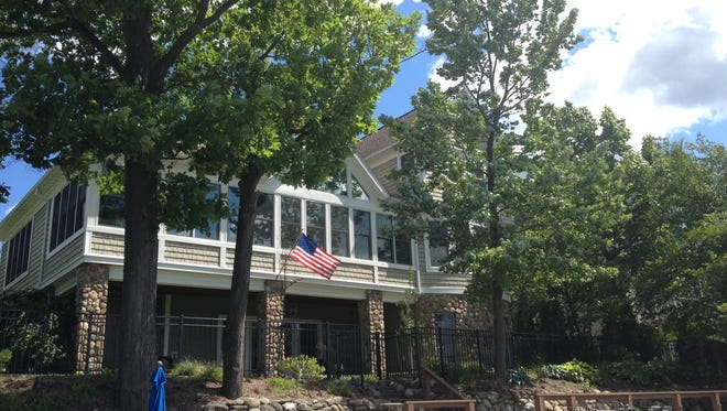 This home at 5080 East Lake Road on Canandaigua Lake in Gorham has a wrap-around sunroom and is listed at $1.7 million.