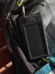 The waterproof solar charger by Outxe charges devices