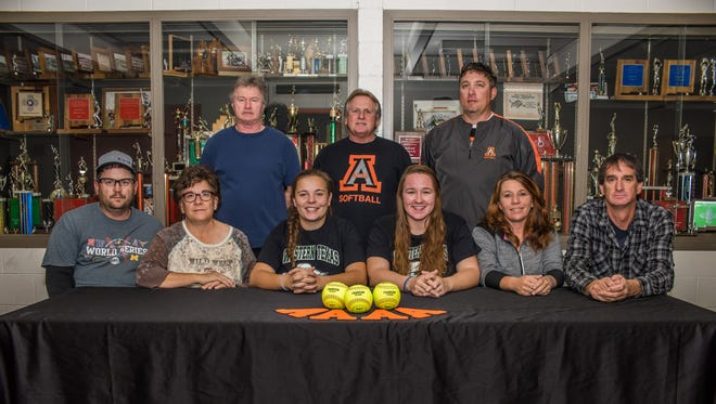 Aztec's CheyAnne Simkins, third from left,  and Ashlynn Bradley, fourth from left, signed letters of intent to play softball for Western Texas College on Nov. 1 at Lillywhite Gym in Aztec.