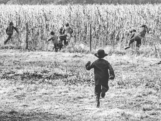 Amish school children run for the cornfields on Nov.