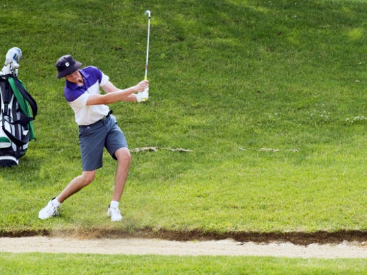 Andrew Davis, of Eastern York High School, hits near a bunker during the York County Junior Golf Association Tournament at Heritage Hills Golf Course. Davis finished third in Tuesday's blue division with a 76, two shots off the pace behind champion Kevin Crumbling.