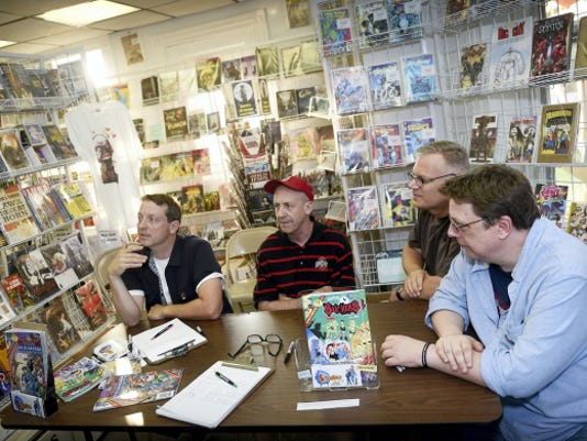 """Comic book legends came to Palmyra Wednesday to autograph some of their newest creations and characters. From left are Darin Henry, a former writer for """"Seinfeld,"""" Jeff Shultz, an artist for """"Archie"""" comics, Glenn Whitmore, a colorist on DC Comics' """"Superman,"""" and Ron Frenz, an artist on Marvel Comics' """"Spiderman."""" They greeted guests and signed autographs for buyers of the new Sitcomics release, """"Suckers and The Blue Baron"""" and Comics and Paperbacks plus in the borough."""