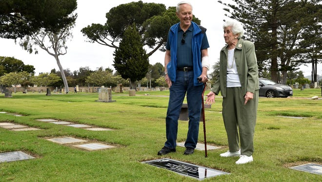 """Sherwood """"Woody"""" Milleman, left, and Val Rains visit a common grave at Ivy Lawn in Ventura, where some of Camarillo's founding residents were moved from local plots several decades ago. The pair worked for many years to identify those buried at the site and were instrumental in getting a grave marker installed."""