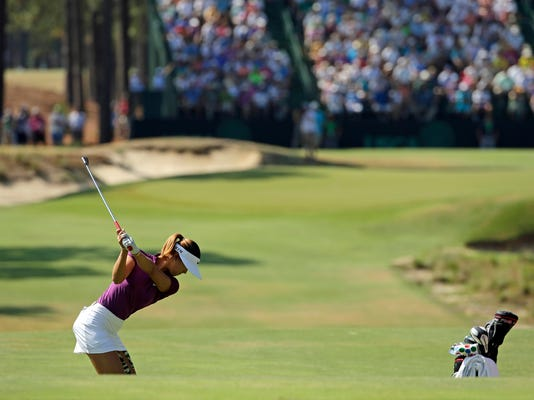 Michelle Wie prepares to hit her tee shot on the 17th hole during the second round of the U.S. Women's Open golf tournament in Pinehurst, N.C., Friday, June 20, 2014. (AP Photo/Chuck Burton)