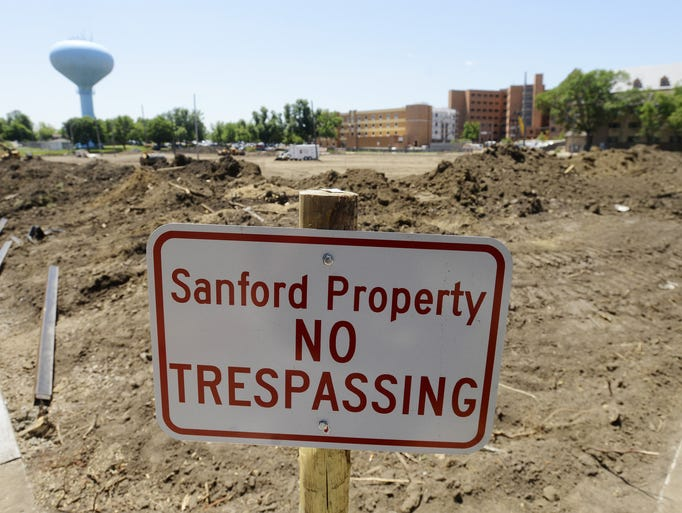 Construction continues on a Sanford parking lot just east of Grange Avenue, July 3, 2014.