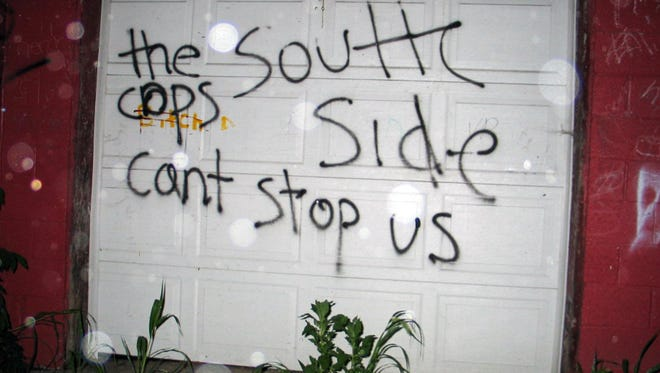 This Southside gang graffiti taunted law enforcement, but a joint investigation into Southside that led to federal indictments against 21 purported gang members disproved that taunting claim.