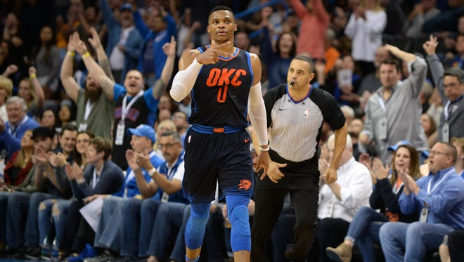 Oklahoma City Thunder guard Russell Westbrook (0) reacts after making a 3 point shot against the San Antonio Spurs during the fourth quarter at Chesapeake Energy Arena.