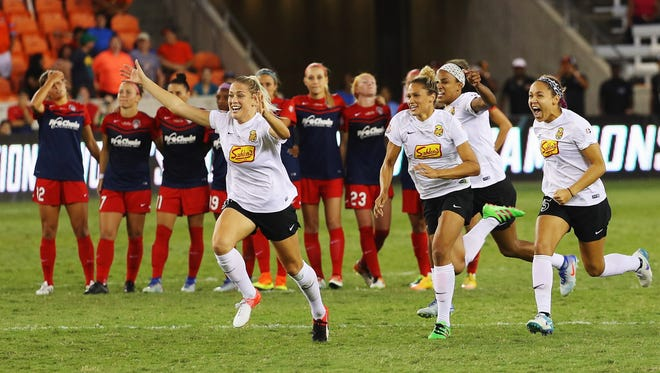 From left, Flash players Abby Dahlkemper, Lynn Williams and Jaelene Hinkle react after Sabrina D'Angelo's penalty kick save that clinched the NWSL Championship on Oct. 9 in Houston.