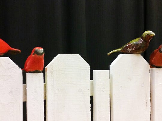 """OTC professor Cathy Clemens continues her work with ceramic birds in this piece titled """"Fenced In."""""""