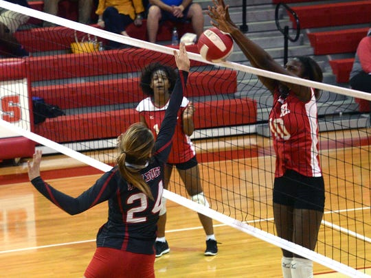 Ruston's Reagan Lee blocks the shot of Haughton's Nicole Barrett last season. The Lady Bearcats will be part of the summer volleyball league starting Thursday evening at Airline.