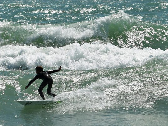 Easter Pro-Am surfing at Lori Wilson park in Cocoa Beach on Sunday. The day's event included a dog surfing competition.
