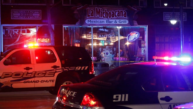 Appleton police investigate the scene inside La Michoacana after two men were stabbed and a third injured Sunday morning.