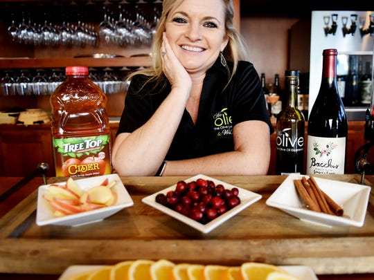 Virginia Calhoun, owner of We Olive & Wine Bar in Shreveport, demonstrates how to make a Spiced Sangria.