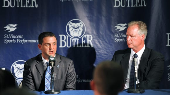 New Butler basketball coach Brandon Miller speaks to the media while athletic directory Barry Collier watches during a news conference announcing Miller's appointment on July 6, 2013.