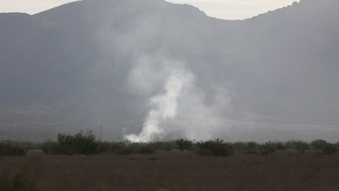 The fire from an F-16 fighter jet that crashed Wednesday night during a training mission with the 162nd wing Arizona Air National Guard, has been contained north of Douglas, Ariz., Thursday June 25, 2015. The pilot has not been found.