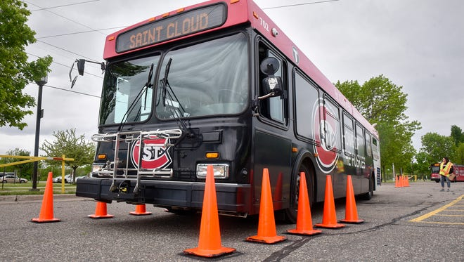 A driver guides a large bus through a series of cones during the Metro Bus Roadeo Thursday, May 18, in a parking lot at St. Cloud State University.