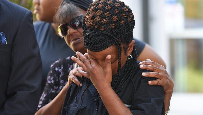 Tamika Gordon, who is the sister of Jermaine Massey, is consoled by their mother Sandra Massey, during a press conference outside the Greenville County courthouse Friday, June 15, 2018 to respond to the news that the solicitor has cleared the deputies involved from any wrongdoing in the shooting death of Massey.