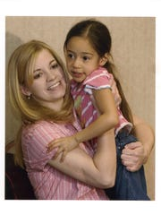 Jessica Lynch with Lori Piestewa's daughter, Carla.