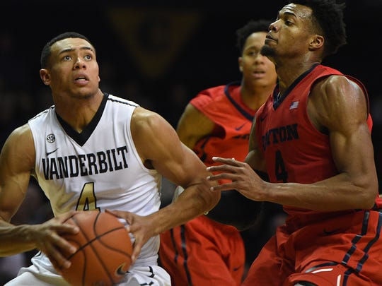 Vanderbilt's Wade Baldwin, left, drives to the basket