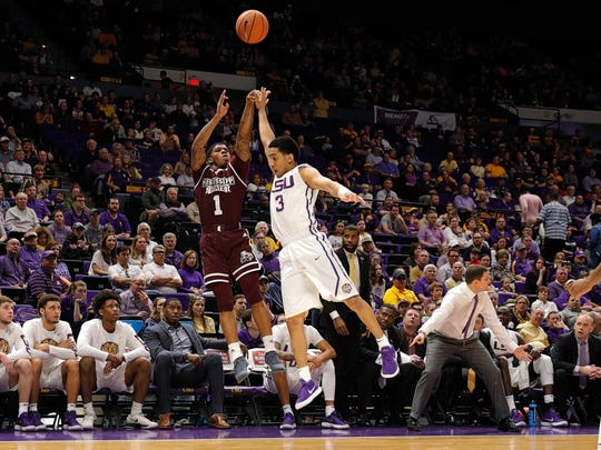 Mississippi State Bulldogs guard Lamar Peters (1) shoots a jump shot in the first half against LSU Tigers guard Tremont Waters (3) at Pete Maravich Assembly Center. Mandatory Credit: Stephen Lew-USA TODAY Sports