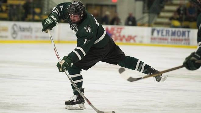 Stowe forward Chad Haggerty (15) shoots the puck during the Vermont state boys division II high school hockey championship game between the Stowe Raiders and the U-32 Raiders at Gutterson Fieldhouse on Thursday in Burlington.