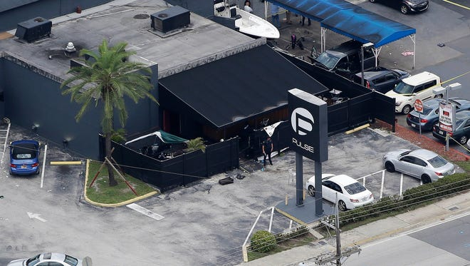 In this June 12, 2016 file photo, law enforcement officials work at the Pulse gay nightclub in Orlando following a mass shooting. (AP Photo/Chris O'Meara, File)