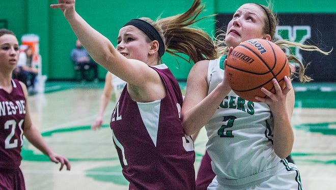 Yorktown's Taylor Foreman shoots past Wes-Del's defense during their game at Yorktown High School Thursday evening.